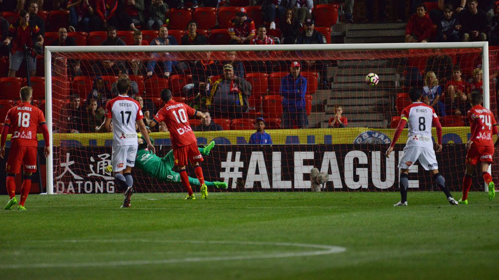 Marcelo Carrusca scores from the penalty spot for Adelaide United. (AAP)