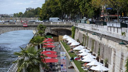 In this July 28, 2020, file photo, people enjoy the sun on deckchairs along the river Seine in Paris.