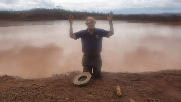 Alf King rejoices as rain fills one of the dams on his property.