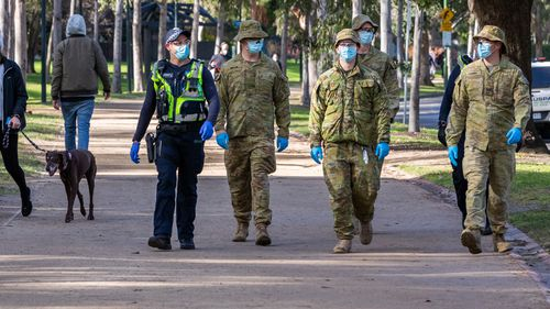 Australian Defense Force (ADF) personnel and Protective service officers are seen on patrol at the Tan running track on August 06, 2020 in Melbourne, Australia.