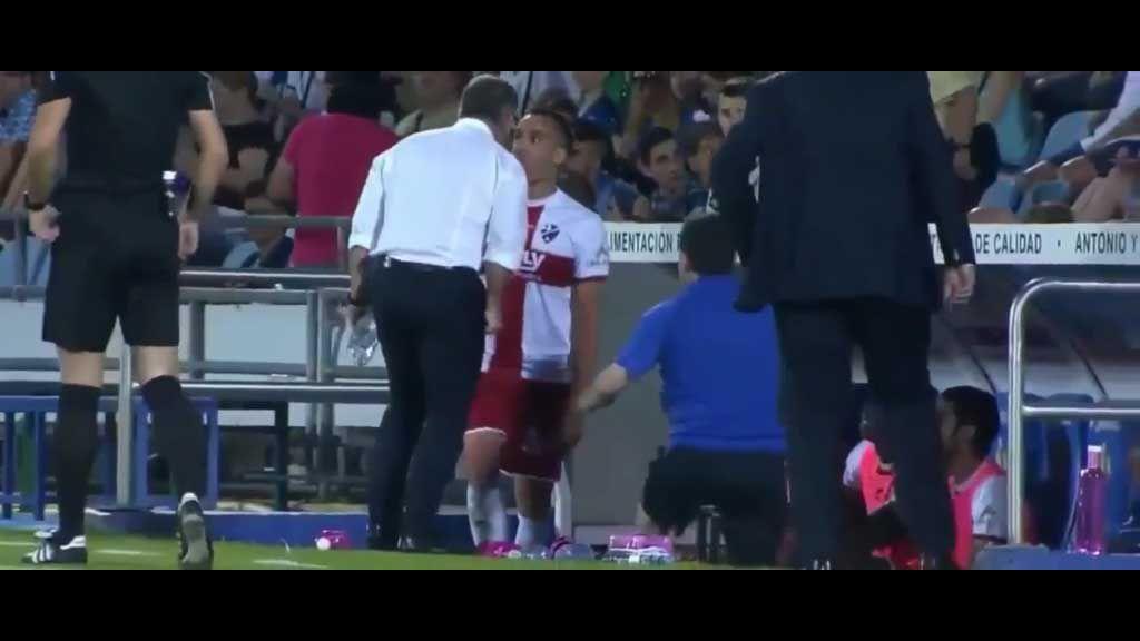 Football coach headbutts player