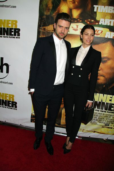 Justin Timberlake and Jessica Biel donned matching black suits and crisp white shirts to the premiere of <em>Runner Runner</em> in September 2013.