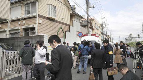 A crowd outside the apartment where Takahiro Shiraishi killed nine people.