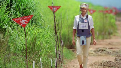 Princess Diana walks through minefields in Angola