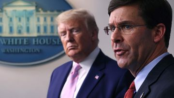 Secretary of Defence Mark Esper speaks as US President Donald Trump listens during a daily White House coronavirus press briefing, in April