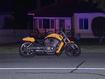 Man 'hanging from car' shoots motorcyclist at close range