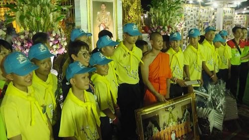 "Thai boys thank ""the world"" as part of an evening ceremony. Picture: AP"