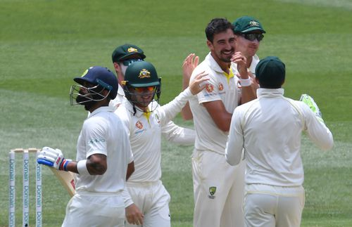 Mitchell Starc and his Aussie teammates, pictured celebrating the wicket of Virat Kohli at the MCG, will travel to England for an Ashes series in August.