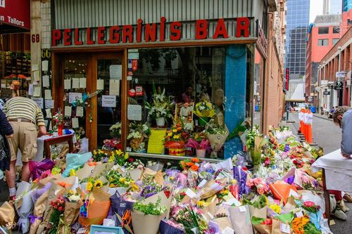 The doors of Pellegrini's were reopened at 8am and a line of mourning customers, some overwhelmed by tears, poured into the shop.