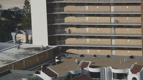The stunt took place 12 metres above a concrete carpark, with the group trespassing on private property. Picture: 9NEWS