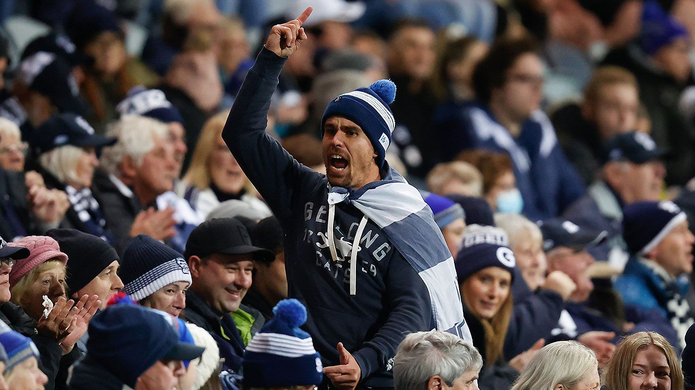Fans baffled by lack of social distancing at AFL clash despite state-imposed capped crowds