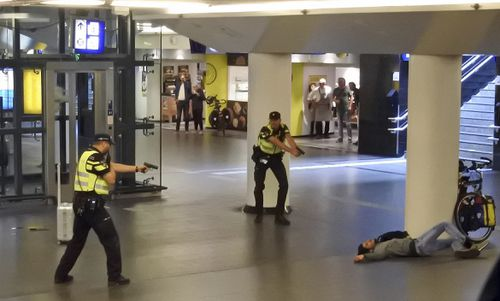 A teenage terror attack suspect was shot in just nine seconds after stabbing two US tourists in Amsterdam.