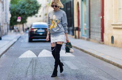 German fashion blogger Lisa Hahnbueck wearing  Acne Studios sweater, Isla skirt, Stuart Weitzman boots, Fendi sunglasses, MCM Milla Mini bag outside Hermes, Paris Fashion Week