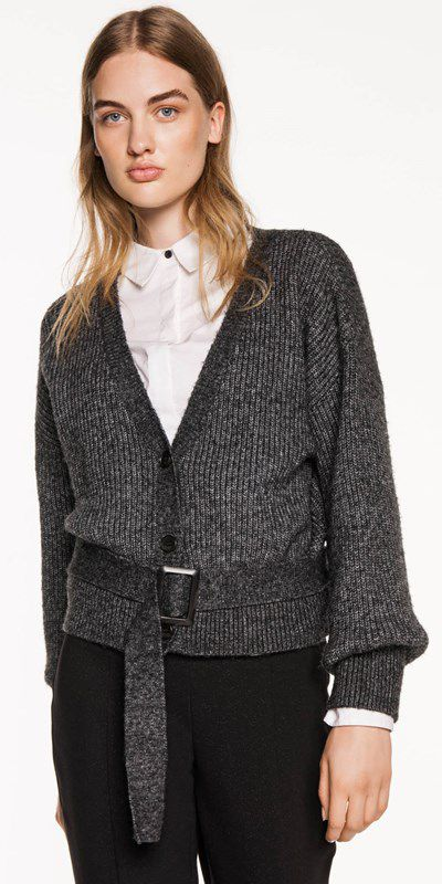 "<p>""At the top of my wool wish list lies the&nbsp;Chunky Belted Cardigan from Cue,"" tells Cowell. ""It's a refreshing take on the standard cardigan. It feels super modern and has a slightly&nbsp;androgynous vibe to it. I would style this layered over a button-up shirt with cropped flare trousers, or contrasted with a super&nbsp;feminine floral dress and white sneakers.""</p> <p><a href=""https://www.cue.cc/Shop/Product/Chunky-Belted-Cardigan-S70303-W18/336461"" target=""_blank"" draggable=""false"">Cue Chunky Belted Cardigan</a>, $200.00&nbsp;</p>"