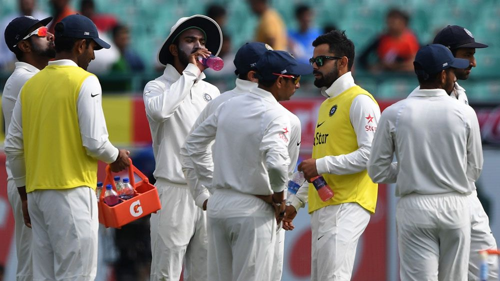 Injured India captain Virat Kohli tries to fire up the troops.