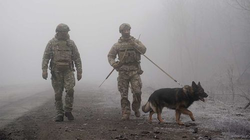 Ukrainian soldiers guard an area near Odradivka, eastern Ukraine.