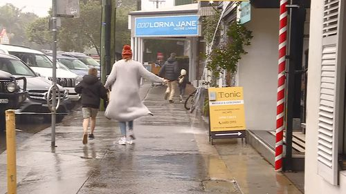 NSW residents run for cover on Sunday as a low brought heavy rain and wild winds to coastal areas.