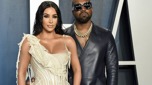 Kim Kardashian West, left, and Kanye West arrive at the Vanity Fair Oscar Party in Beverly Hills, California.
