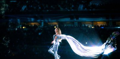 The shimmering cape upped the wow-factor of the sparkling bodysuit.