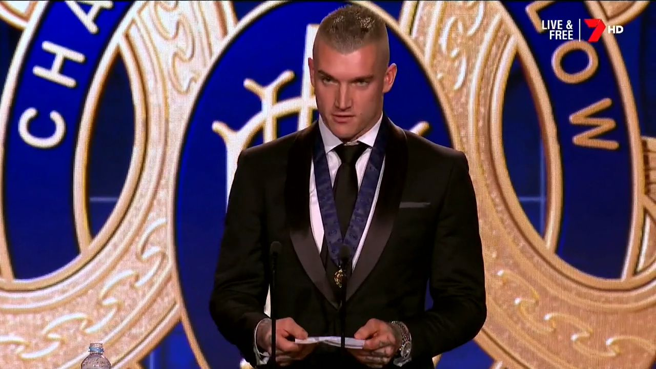 Martin pays emotional tribute to parents after winning Brownlow