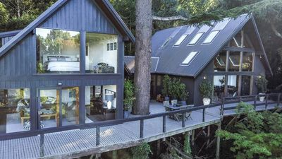 This real-life Canadian tree house with Scandi style is for sale in Australia