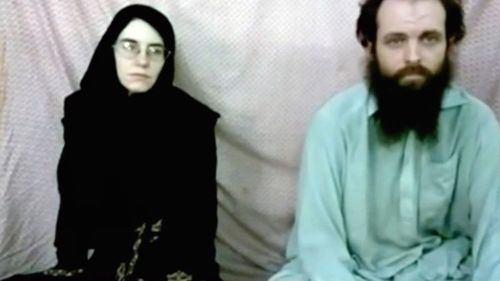 Caitlan Coleman and her husband, Canadian Joshua Boyle appear in a militant video given to their families. (AAP)