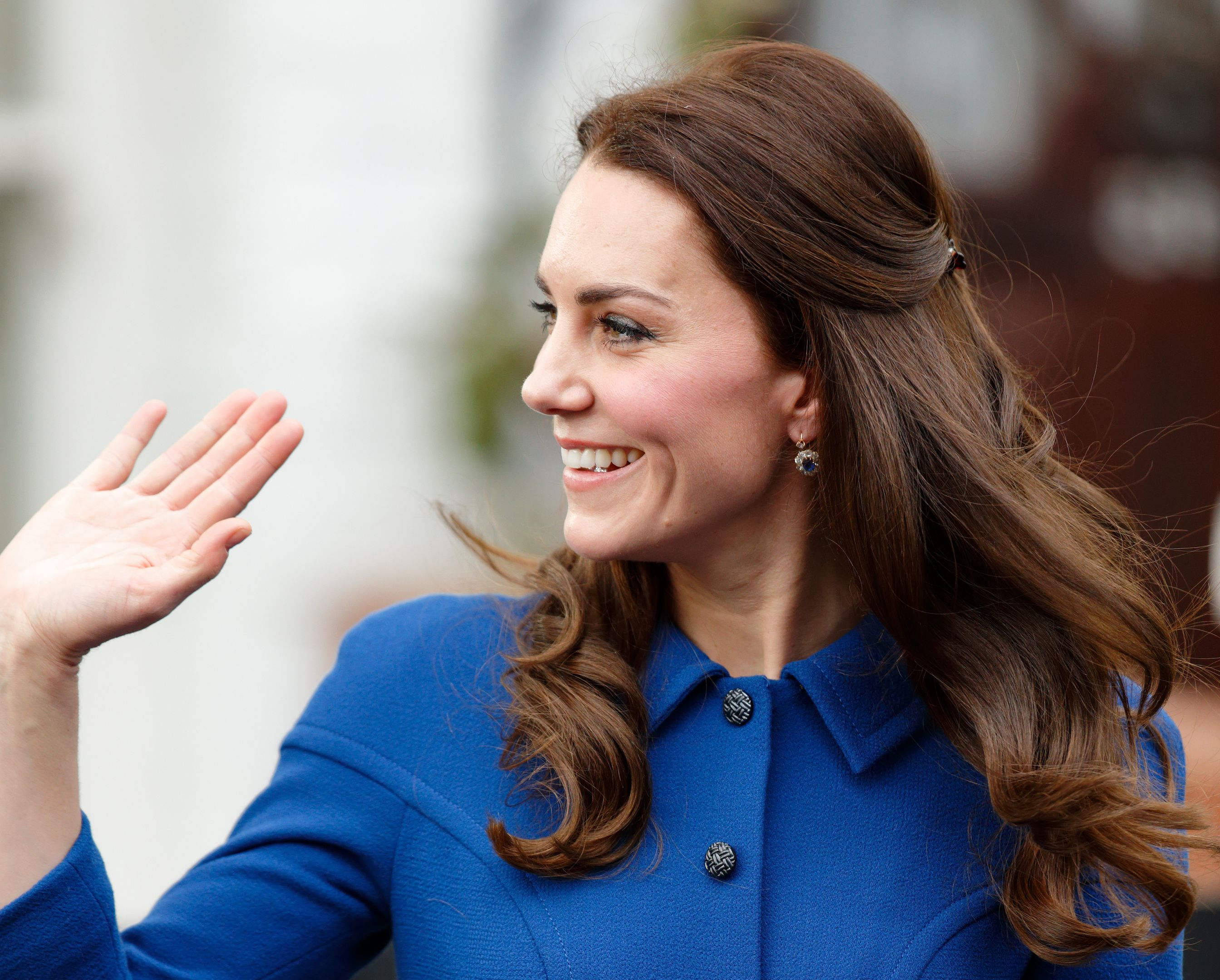 Duchess of Cambridge Kate Middleton steps out in a cobalt blue coat - eerily similar to one Princess Di wore. Image: Getty.