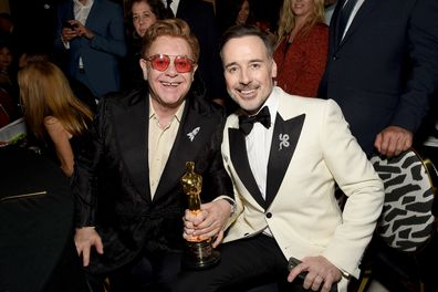 """Winner of Academy Award for Best Original Song from """"Rocketman"""" Elton John and David Furnish attend the 28th Annual Elton John AIDS Foundation Academy Awards Viewing Party."""