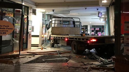 Police are still hunting for two men responsible for ramming two stolen vehicles in a Melbourne shopping centre to steal an ATM.