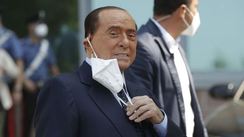 Italian former Premier Silvio Berlusconi adjusts his face mask as he leaves the San Raffaele hospital after testing positive for COVID-19, in Milan, Italy Monday, Sept. 14, 2020