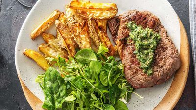 Sirloin steak with parmesan fries and mint-caper salsa verde