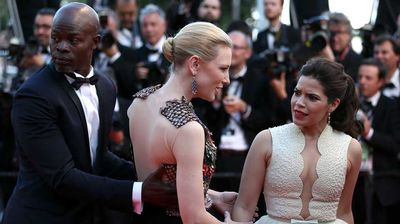 America Ferrera talks to Cate Blanchett as Djimon Hounsou stands nearby. (Getty)