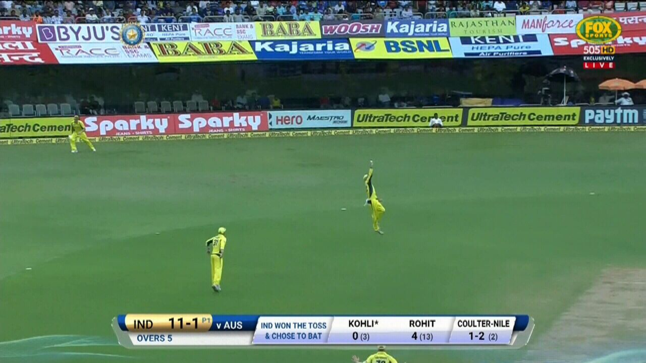 Maxwell stretches high to dismiss Kohli for a duck