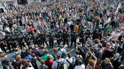 Russian riot police faces a huge crowd of participants of an unauthorized liberal opposition rally, called by their leader Alexei Navalny, prior to the official inauguration of president Putin. (EPA)
