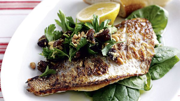 Pan-fried fish with lemon and spinach salad. Image: Australian Women's Weekly