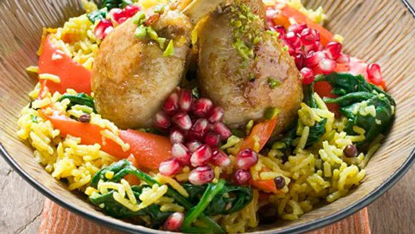 Chicken drumsticks with saffron rice and pomegranate seeds