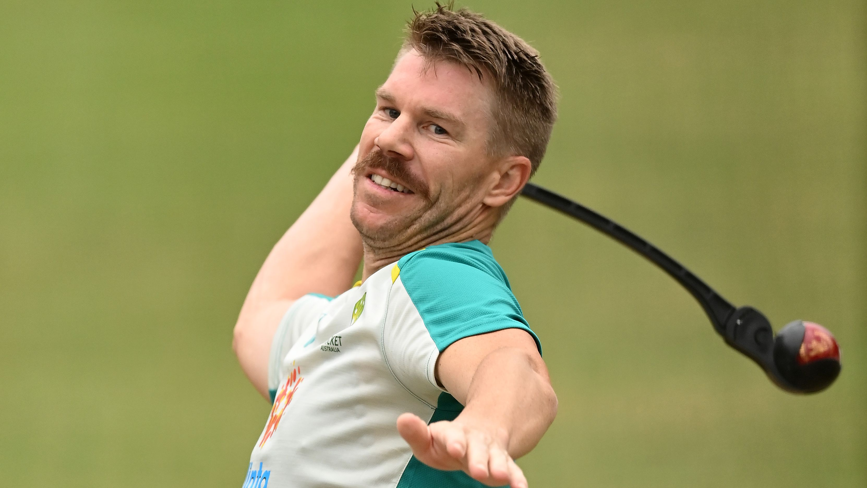 David Warner of Australia warms up in the nets.