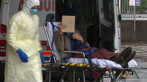 Dr Parker as he is wheeled into hospital. (9NEWS)