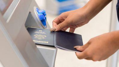 Passport being inserted into passport reader