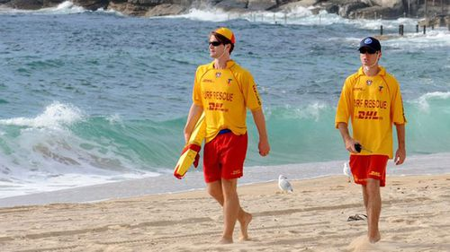 Lifesavers from four clubs were involved in the rescue at Forresters Beach, after police were called about three people in distress in the water