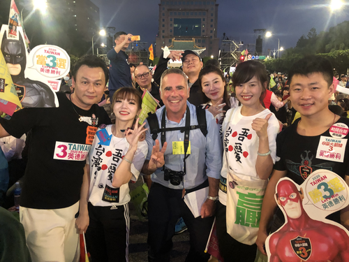 Michael Smith covering the Taiwan presidential elections in January 2020 with crowds of voters in Taipei.