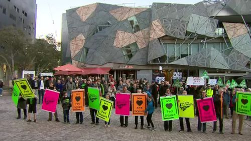 Protesters at the Melbourne landmark this evening.