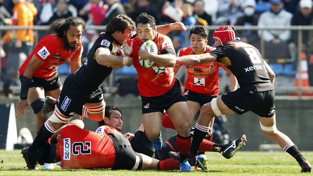 A Sunwolves player cuts through the Lions' defence. (AAP)