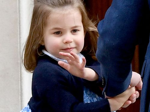 Princess Charlotte waves to the crowd. (PA/AAP)