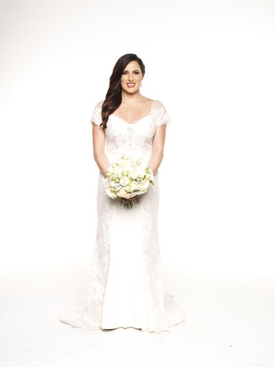 "Structured lace panelling highlight Vanessa Belvedere's slim waist while a sweetheart neckline provides the drama in this <a href=""http://www.raffaeleciuca.com.au/wedding-dresses/"" target=""_blank"">Raffaele Ciuca gown Tatianna</a> designed by Maggie Sottero. Her marriage to Andrew was an emotional event. We're not so sure how long this union is going to last. Fingers crossed."