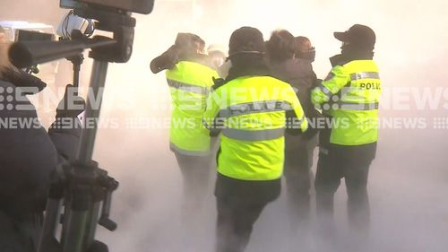 At least one protester was arrested. (9NEWS)