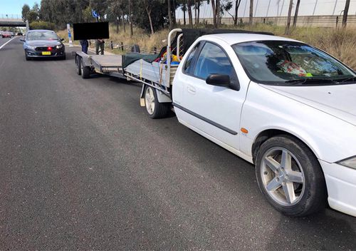 The Ford Falcon was stopped by officers as part of Strike Force Puma, along the M7, near Kings Park.