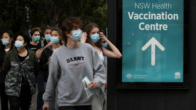 People arrive to be vaccinated at the New South Wales Health mass vaccination hub in Homebush.