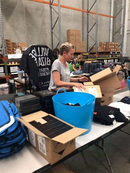 Jen Armstrong sorts out at supplies at the Beauty Bank warehouse.