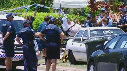 Paramedics assist a person through the police cordon. (9NEWS)